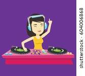 asian dj in headphones at the... | Shutterstock .eps vector #604006868
