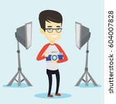 asian photographer holding a... | Shutterstock .eps vector #604007828