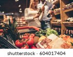 at the supermarket. shopping... | Shutterstock . vector #604017404