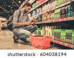 handsome man is choosing... | Shutterstock . vector #604038194