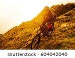 enduro cyclist riding the... | Shutterstock . vector #604042040
