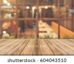 wooden board empty table top on ... | Shutterstock . vector #604043510
