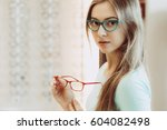 young woman trying on different ... | Shutterstock . vector #604082498