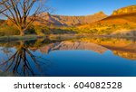 Reflections Of Mountains In A...