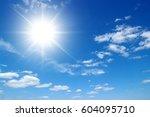 sun on blue sky backgrounds | Shutterstock . vector #604095710