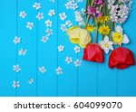 Tulips On A Wooden Background....