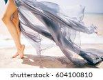 woman legs  girl in blue waving ... | Shutterstock . vector #604100810