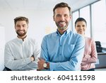 group of happy  motivated... | Shutterstock . vector #604111598