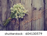 summer flowers on vintage... | Shutterstock . vector #604130579