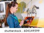 girl in painting studio | Shutterstock . vector #604149599