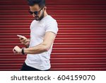 handsome young bearded man in... | Shutterstock . vector #604159070