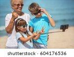 grandmother with grandchildren... | Shutterstock . vector #604176536