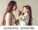 charming little girl and her... | Shutterstock . vector #604201208