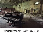 old ruined grand piano in a... | Shutterstock . vector #604207610