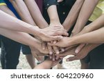 unity teamwork business and... | Shutterstock . vector #604220960