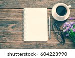 notebook coffee cup and pen... | Shutterstock . vector #604223990