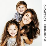 Small photo of two pretty children kissing their mother happy smiling close up