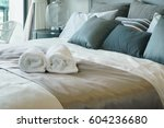 white towels on bed in stylish... | Shutterstock . vector #604236680