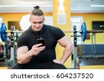 young handsome man using phone... | Shutterstock . vector #604237520