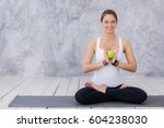 girl is engaged in yoga on a... | Shutterstock . vector #604238030