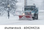 Snow Plow Is Plowing The Roads...