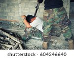 terrorist in balaclava...   Shutterstock . vector #604246640