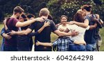 group of people huddle together ... | Shutterstock . vector #604264298