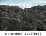 Small photo of a slice blue sea with large acreage rock