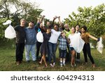 diverse group of people pick up ... | Shutterstock . vector #604294313