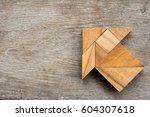 tangram puzzle in arrow shape... | Shutterstock . vector #604307618