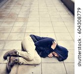 young man homeless sleep on the ... | Shutterstock . vector #604308779