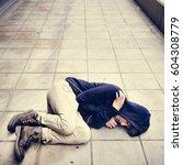 young man homeless sleep on the ... | Shutterstock . vector #604308779