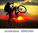 Small photo of Rider on bike on sunset
