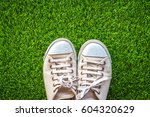 close up of white sneakers on... | Shutterstock . vector #604320629
