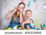 mother teaches kid to do craft... | Shutterstock . vector #604329800