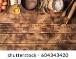 baking ingredients on a wooden...   Shutterstock . vector #604343420