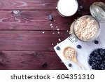 oatmeal flakes with blueberry... | Shutterstock . vector #604351310