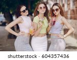 three young models are walking... | Shutterstock . vector #604357436