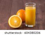 fresh orange juice with sliced... | Shutterstock . vector #604380206