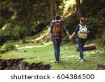 a couple hikers hiking with... | Shutterstock . vector #604386500