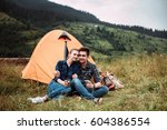 a couple of tourists in time of ... | Shutterstock . vector #604386554