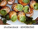 escargots de bourgogne   snails ... | Shutterstock . vector #604386560