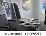 flying by business class... | Shutterstock . vector #604399058
