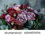 A Bouquet Of Roses In A Wooden...