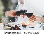 happy friends cheering with... | Shutterstock . vector #604419338