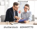 young managers discussing... | Shutterstock . vector #604449770