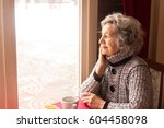 lonely senior woman sitting and ... | Shutterstock . vector #604458098