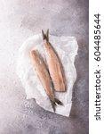 freshly salted herring on gray... | Shutterstock . vector #604485644