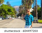 young man standing on the... | Shutterstock . vector #604497203