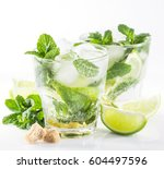 mojito cocktail with lime and... | Shutterstock . vector #604497596